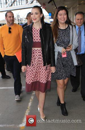 Jaime King - Jaime King arrives on a flight to Los Angeles International Airport (LAX) in silver high heels and...