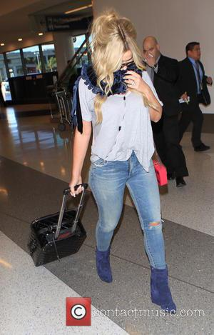 Kim Zolciak - Don't Be Tardy star Kim Zolciak departs on a flight from Los Angeles International Airport (LAX) carrying...