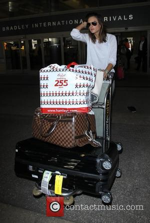 Alessandra Ambrosio - Alessandra Ambrosio arrives on a flight from London Heathrow to Los Angeles International Airport (LAX) pushing her...