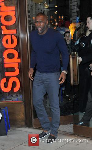 Idris Elba - Idris Elba attends a photocall to launch the Superdry AW15 Premium Menswear collection at Superdry International Showroom...