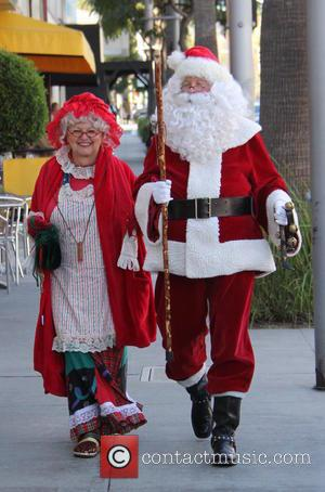 Santa Claus , Mrs Claus - A couple dressed up as Santa Claus and Mrs Claus taking a walk together...