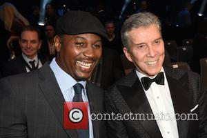 Lennox Lewis and Michael Buffer