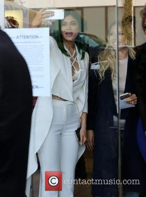 Kylie Jenner - Kylie Jenner sports her green hair with an all white outfit as she visits the Dash store...