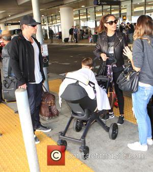 Nick Lachey , Vanessa Lachey - Nick Lachey arrives on a flight to Los Angeles International Airport (LAX) with family...
