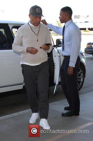 Russell Simmons - Russell Simmons departs on a flight from Los Angeles International Airport (LAX) - Los Angeles, California, United...