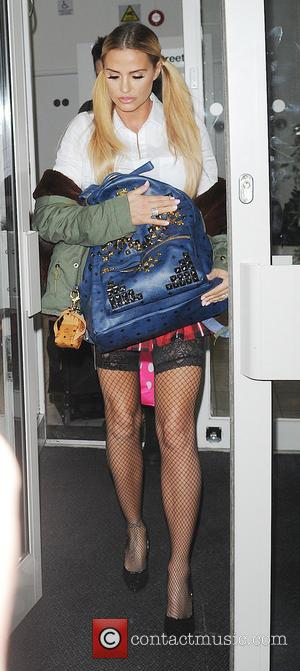 Katie Price - Katie Price leaving Premier Models after promoting her new app. - London, United Kingdom - Wednesday 2nd...