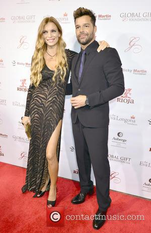 Esther Canadas and Ricky Martin