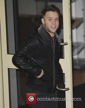 Olly Murs - 'The X Factor' judges Simon Cowell and Olly Murs leave the studios after a day of rehearsals...