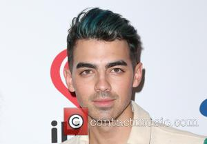 Joe Jonas - KIIS FM's iHeartRadio Jingle Ball 2015 at Microsoft Theater - Arrivals at STAPLES Center - Los Angeles,...