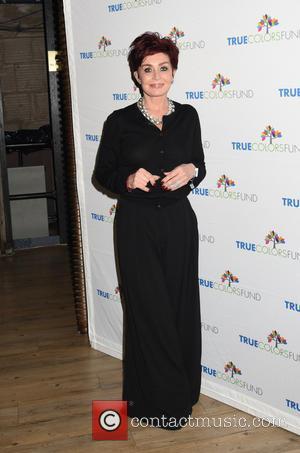 Sharon Osbourne Kicks Off Stage Crasher At People's Choice Awards
