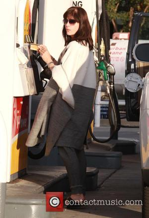 Selma Blair - Selma Blair fills her car up with gas in Studio City - Los Angeles, California, United States...