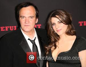 Quentin Tarantino and Courtney Hoffman