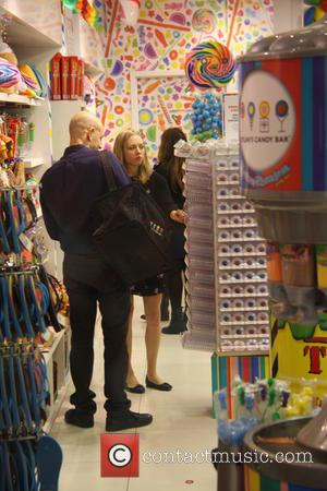 Amanda Seyfried - Amanda Seyfried shopping for sweets at Dylan's Candy Bar at The Grove with a male companion at...