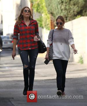 Ashley Benson - Ashley Benson out and about in Beverly Hills wearing a red checked lumberjack shirt; torn skinny jeans...