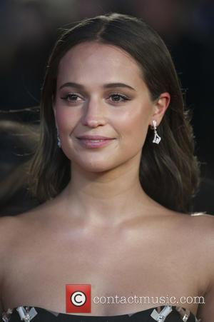Alicia Vikander - Celebrities attends the UK Premiere of the Danish Girl at the Odeon Leicester Square in London. at...