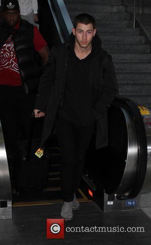 Nick Jonas - Nick Jonas arrives on a flight to Los Angeles International Airport (LAX) - Los Angeles, California, United...