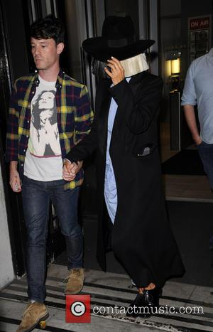 Sia - Sia is helped in to BBC Radio 2 - London, United Kingdom - Tuesday 8th December 2015