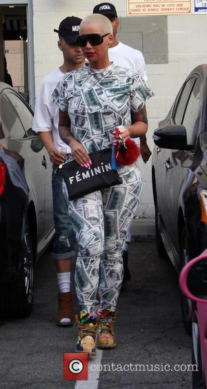 Amber Rose - Amber Rose leaves a nail salon in Beverly Hills in a $100 patterned trouser suit and colourful...