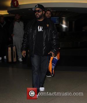 Ice Cube - Ice Cube arrives at Los Angeles International Airport with his son O'Shea Jackson Jr - Los Angeles,...