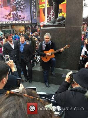 Andrea Bocelli - This afternoon, renowned tenor Andrea Bocelli performs an impromptu acoustic guitar gig in Times Square after noticing...