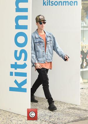 Justin Bieber - Justin Bieber spotted shopping at Kitson Men and stops for a photo with a fan on his...