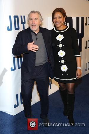Robert De Niro , Grace Hightower - New York premiere of 'Joy' at the Ziegfeld Theater - Arrivals at Ziegfeld...