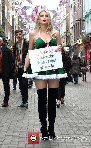 Ashley James - Dressed as Santa's Little Helper, Ashley James teamed up with PETA to encourage shoppers in London's trendy...