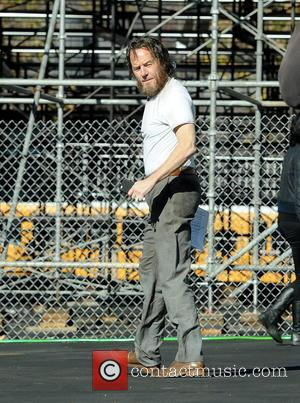 Bryan Cranston - Actor Bryan Cranston gets into character as a homeless man on the set of
