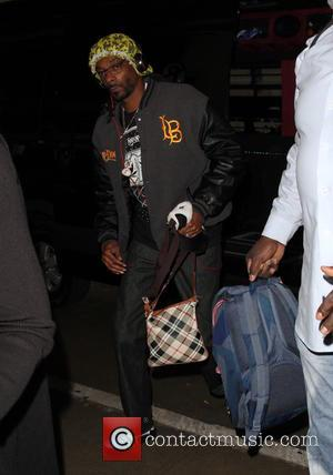 Snoop Dogg , Snoop Lion - Snoop Dogg departs on a flight from Los Angeles International Airport (LAX) - Los...