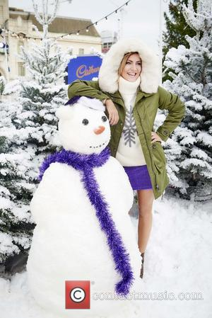 Caroline Flack - Today (14Dec15), Cadbury turned Woolwich, London into a Cadbury White Christmas, with real, pristine, fluffy snow for...