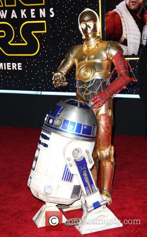 R2-D2 , C-3PO - Celebrities attend Premiere Of Walt Disney Pictures And Lucasfilm's