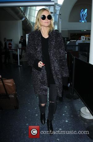 Heidi Klum - Heidi Klum arrives at Los Angeles International Airport (LAX) - Los Angeles, California, United States - Tuesday...