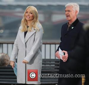 Holly Willoughby , Philip Schofeild - Holly Willoughby and Philip Schofeild filming on the south bank outside ITV Studios -...