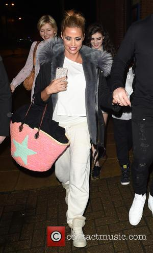 Katie Price - Katie Price along with husband Kieran Hayler seen leaving new working theatre with children Princess and Junior....
