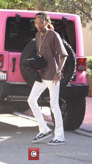 Wiz Khalifa - Amber Rose dressed in a FVCKA jogging suit, takes her son to the park with husband Wiz...