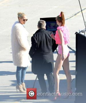 Heidi Klum - Super Model Heidi Klum sports a mink coat while filming scenes and photoshoots for