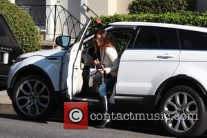 Katie Cleary - Katie Cleary can be seen stepping out of her White Range Rover in Beverly Hills carrying Sharkk...