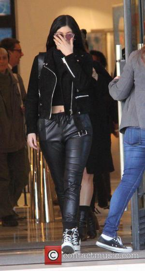 Kylie Jenner - Kylie Jenner covers her face as she leaves Barneys New York in Beverly Hills as she shows...