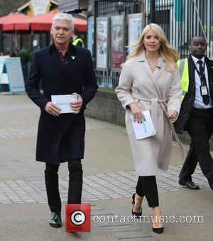 Holly Willoughby , Phillip Schofield - Holly Willoughby and Phillip Schofield filming on the South Bank outside ITV Studios at...