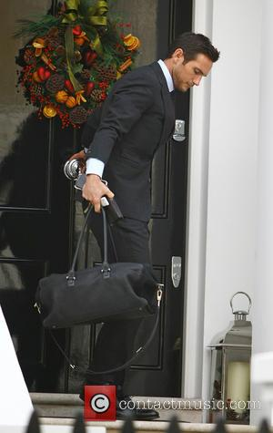Frank Lampard - Frank Lampard leaving home, wearing a smart suit and tie. at chelsea - London, United Kingdom -...