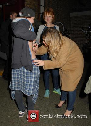 Kimberley Walsh - Kimberley Walsh leaving the Dominion Theatre after performing in 'Elf the Musical' autographing on a fans stomach...