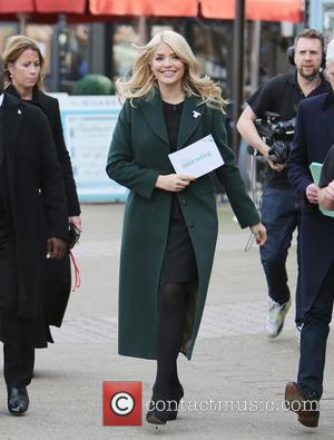 Holly Willoughby - Holly Willoughby and Phillip Schofield filming on the south bank outside ITV Studios - London, United Kingdom...