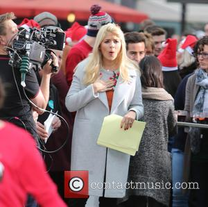 Holly Willoughby - Holly Willoughby and Phillip Schofield filming on the South Bank outside ITV Studios at South Bank -...
