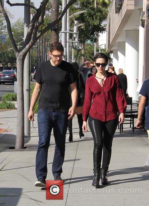 Emmy Rossum , Sam Esmail - Emmy Rossum looks tense while out and about with her fiancé, Producer Sam Esmail,...