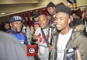 Floyd Mayweather , Lil Caine The Artist - Floyd Mayweather is photographed in the locker room with rapper Lil Caine...