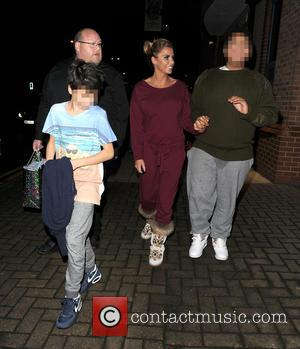 Katie Price, Harvey Price , Junior Andre - Katie Price leaves the New Victoria Theatre in Woking, with her two...
