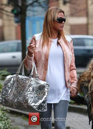 Katie Price , Jordan - Katie Price arrives at the New Victoria Theatre in Woking with her daughter Princess -...