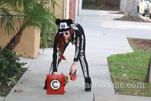 Phoebe Price - Phoebe Price seems confused about what holiday it is as she is spotted wearing a Halloween outfit...