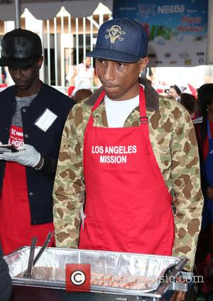 Pharrell Williams - Los Angles Mission Christmas Meal to the Homeless at Los Angles Mission - Los Angeles, California, United...