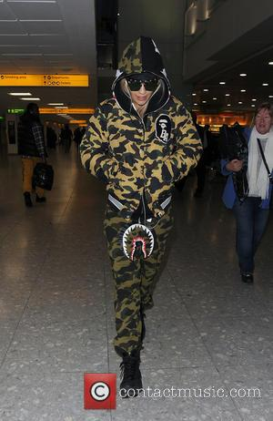 Rita Ora - Rita Ora arrives home for Christmas, on a flight from Hong Kong, with her sister Elena Ora....